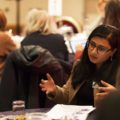 person engaged in discussion at conference