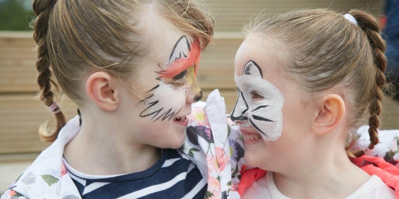 Two girls with face paint smiling