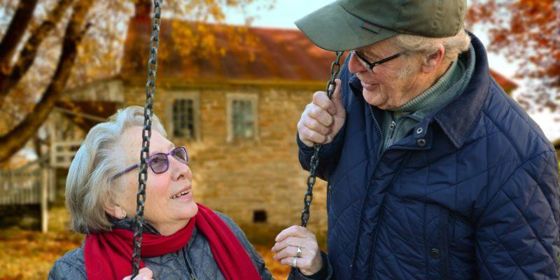 Older lady smiling at older man
